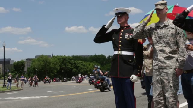 ls an unidentified us marine and us army private 1st class colin salute as participants of the annual rolling thunder parade pass by may 25 2014... - saluting stock videos & royalty-free footage