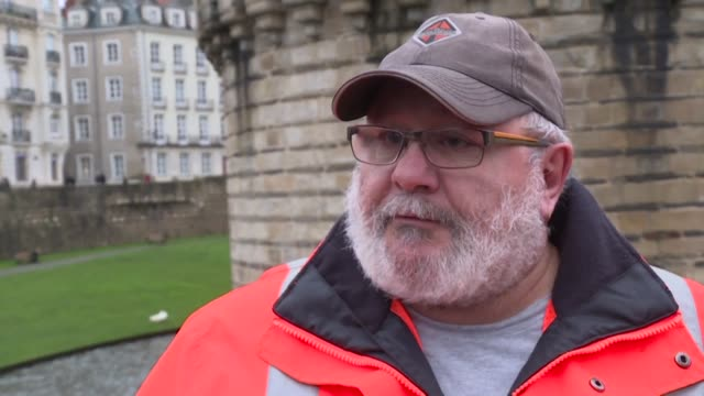 an unjust reform which puts an end to the pay as you go system : teachers and a pensioner from the steel industry who met at the demonstration in... - nantes stock videos & royalty-free footage