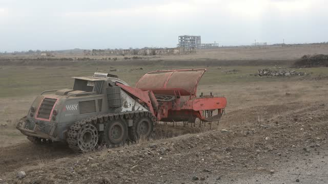 an unmanned mine clearing vehicle device of the azerbaijan national agency for mine action demining landmines near the town of agdam that was... - 14 15 years stock videos & royalty-free footage