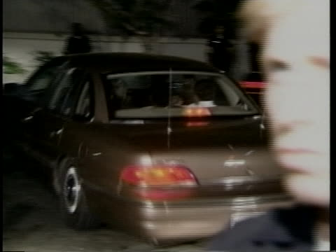 an unmarked police car carries suspected murderer o.j. simpson. - arrest stock videos & royalty-free footage