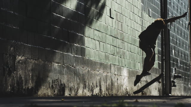 an unrecognizable man skateboarding in the streets of brooklyn, nyc - courage stock videos & royalty-free footage