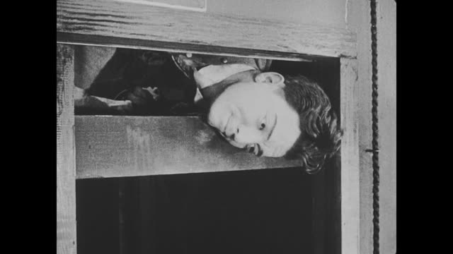1918 an unruly horse that is responsible for pulling the elevator up and down causes bellhop's (buster keaton) head to get stuck in the elevator and miss cutie cuticle to be catapulted onto a deer head that hangs in the hotel - buster keaton stock videos and b-roll footage