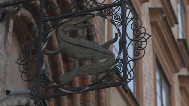 an unusual shop sign features a reptile in warsaw - shop sign stock videos & royalty-free footage