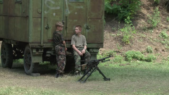 an unusual type of holiday camp in hungary is proving popular with adolescents hungry for a taste of army life. mogyorod, hungary. - holiday camp stock videos & royalty-free footage