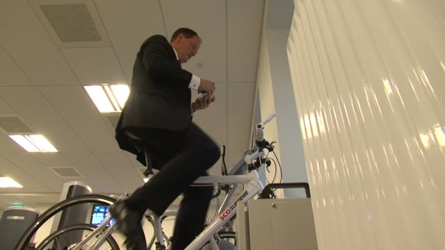 an upmarket hotel in copenhagen is asking guests to help produce the building's electricity by climbing onto stationary bikes copenhagen denmark - oresund region stock videos & royalty-free footage