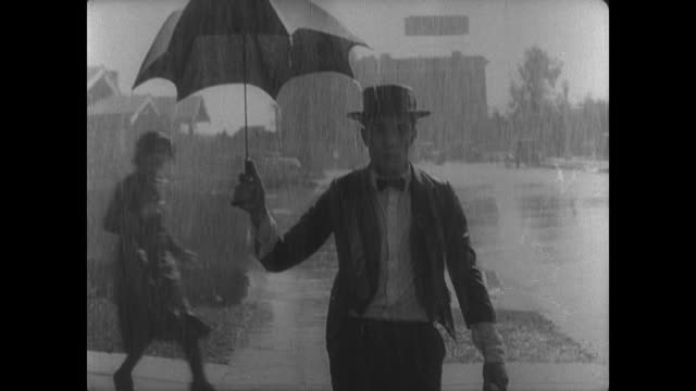 1927 An upset and preoccupied man (Buster Keaton) is unaware that he has arrived home