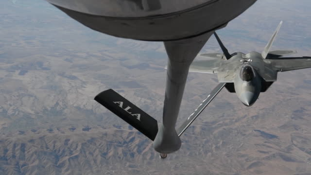 an u.s. air force kc-135 stratotanker refuels a f-22 raptor over northern iraq. - us air force stock videos & royalty-free footage