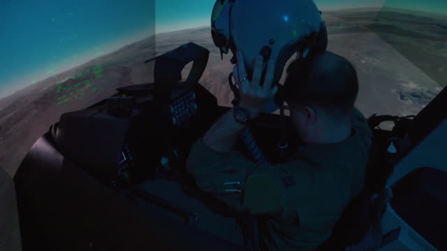 an us air force pilot conducts training in an f16 fighting falcon simulator at arlington texas the simulator models all of the fighter aircrafts... - 米国空軍点の映像素材/bロール