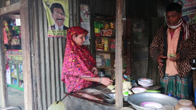 an women running a small shop at barguna bangladesh on january 21 2018 the sundarbans which means 'beautiful jungle' in bengali is the world's... - unesco stock videos & royalty-free footage