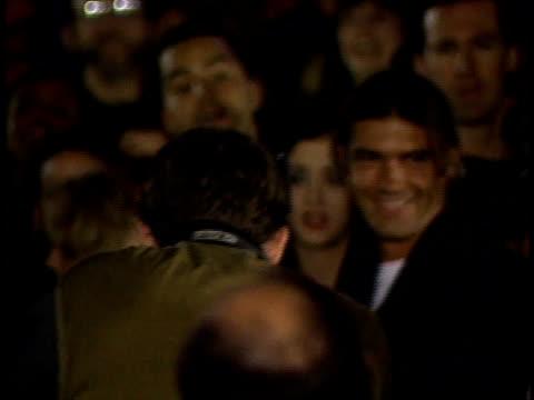 Ana Leza and Antonio Banderas walking through crowd at an event ZO WS Photographers and paparazzi taking photographs