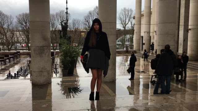 anabel maldonado wears cos boots zara shirt chloe bag and chinti and parker poncho as she arrives at the rochas show street style paris fashion week... - chloe designer label stock videos and b-roll footage