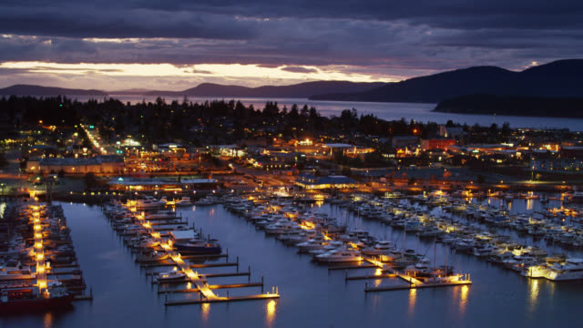 anacortes and fidalgo bay at nightfall - aerial - anacortes stock videos & royalty-free footage