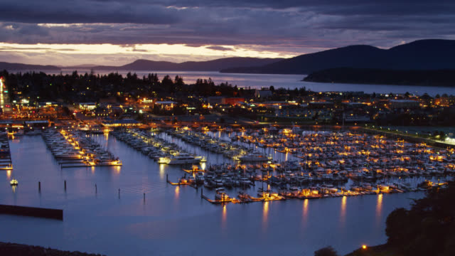 anacortes marina lit up at twilight - aerial - puget sound stock videos & royalty-free footage