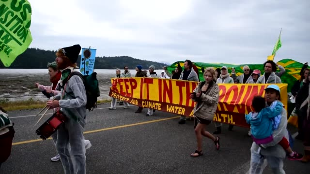 protesters gather on march's point road in anacortes to protest oil - anacortes stock videos & royalty-free footage