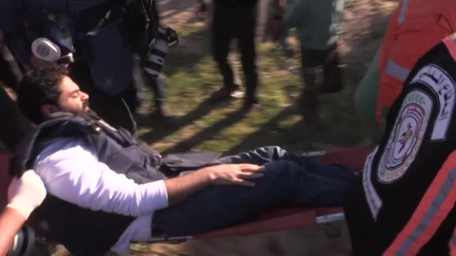anadolu agency photojournalist mustafa hassona is shot by israeli forces' tear gas can and carried away during great march of return demonstrations... - photojournalist stock videos & royalty-free footage