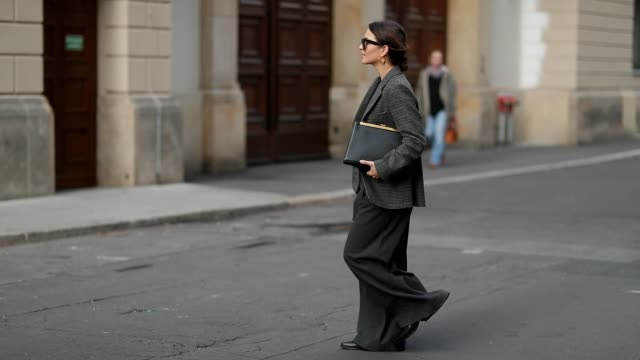 Anais Eleni is seen wearing grey other stories blazer grey high waist Sea NY pants black Massimo Dutti boots Celine bag and sunglasses on November 10...