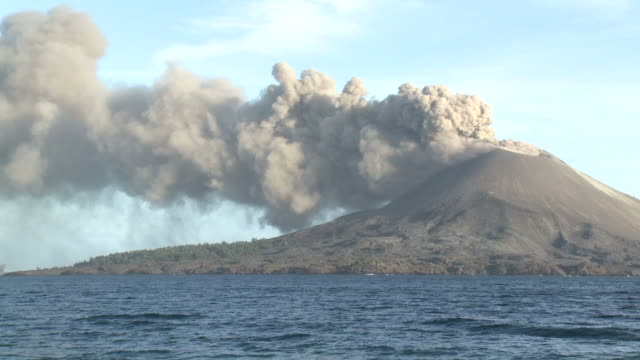 anak krakatau volcano erupts ash in afternoon sunlight over ocean, krakatoa, indonesia, november 2010 - indonesia volcano stock videos & royalty-free footage
