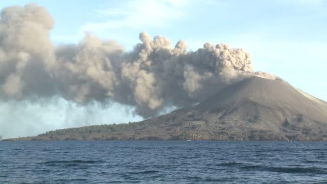 anak krakatau volcano erupts ash in afternoon sunlight over ocean, krakatoa, indonesia, november 2010 - island stock videos & royalty-free footage
