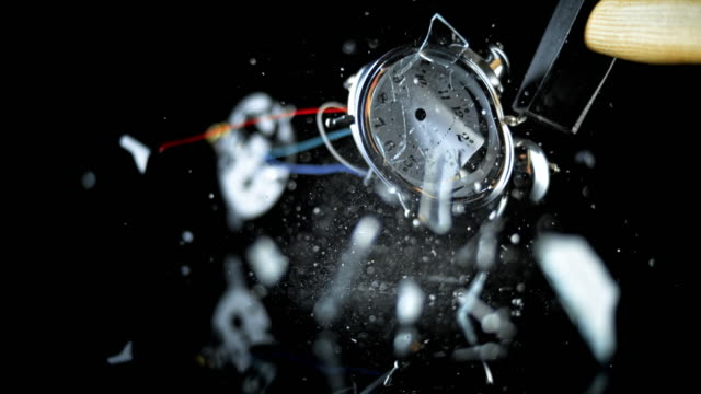 slo mo ld analog alarm clock smashed with a hammer - alarm clock stock videos & royalty-free footage