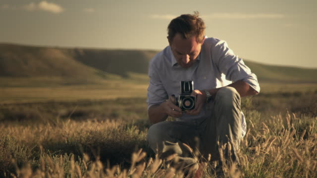 Analog photographer on field