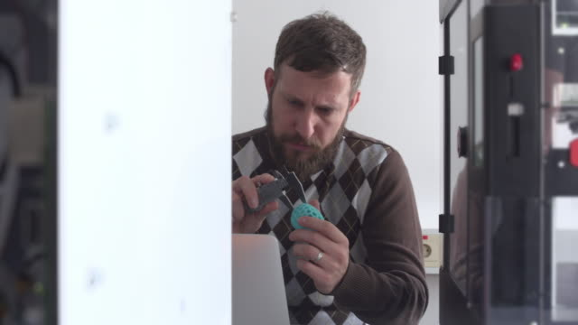 analyzing objects from 3d printer - examining stock videos & royalty-free footage