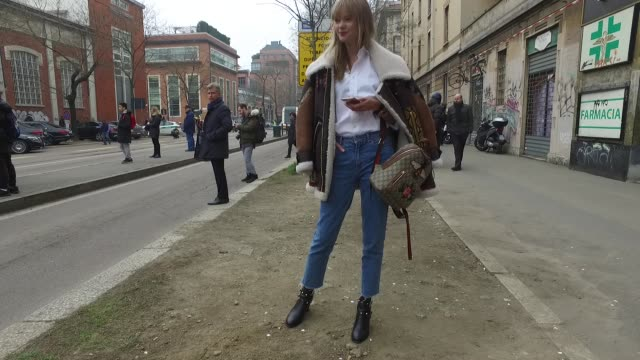 Anastasia Masiutkina Dambrosio is wearing a Burberry jacket Gucci backpack Valentino shoes and HM jeans during Milan Fashion Week Fall Winter 2017/18...