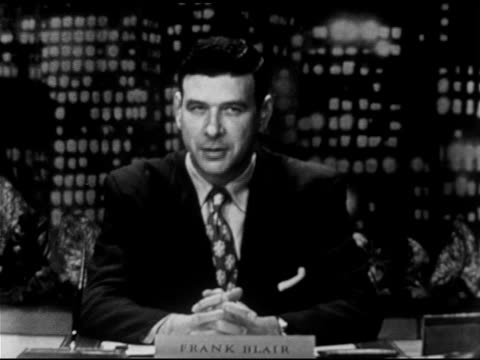 anchor frank blair sitting behind desk on set w/ night cityscape bg sot saying taft made previous statement during new hampshire primary whole nation... - 1952 bildbanksvideor och videomaterial från bakom kulisserna