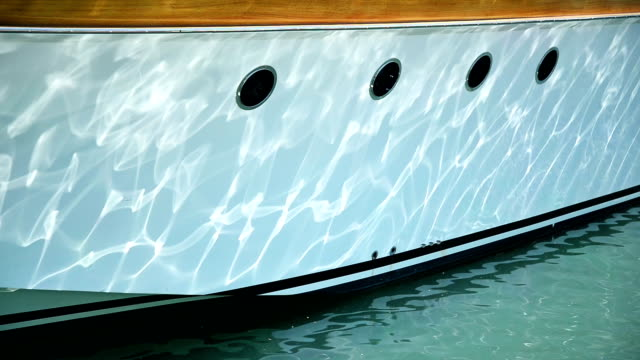 anchored boat in harbor. - moored stock videos & royalty-free footage