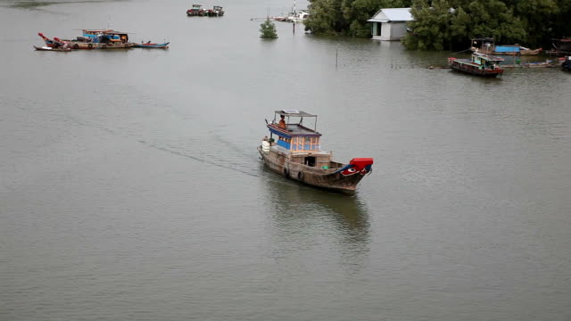 anchored boat in saigon river - anchored stock videos & royalty-free footage