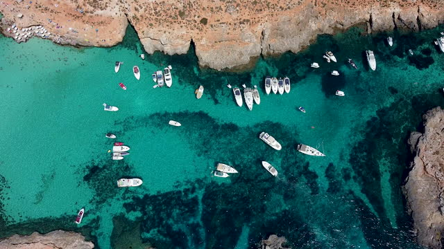 anchored boats near coastline in beautiful turquoise sea. - anchored stock videos & royalty-free footage