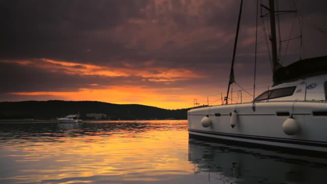 HD DOLLY: Anchored Catamaran At Sunset