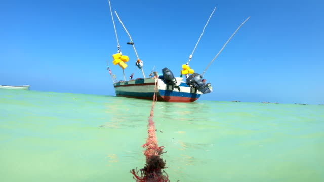 anchored fishing boat near tropical island - anchored stock videos & royalty-free footage