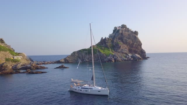 anchored sailboat aerial drone view near islands mamma mia cliff in greece. - anchored stock videos & royalty-free footage