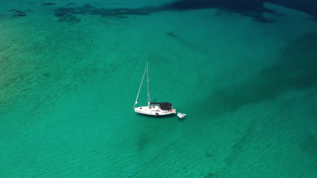 anchored sailboat, view from drone - anchored stock videos & royalty-free footage