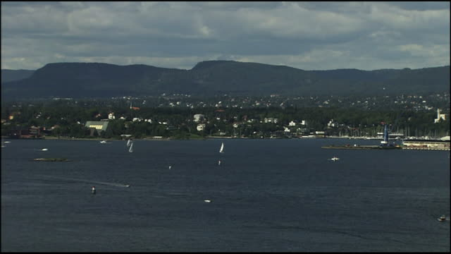 anchored ships line a port in oslo, norway. - anchored stock videos & royalty-free footage