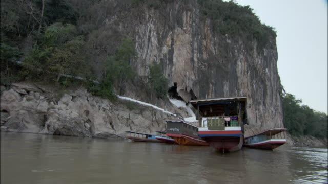 WS LA POV Anchored tourboats in Mekong River , Cambodia