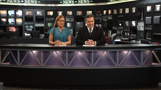 MS Anchors presenting news and drinking champagne afterwards, Dallas, Texas, USA