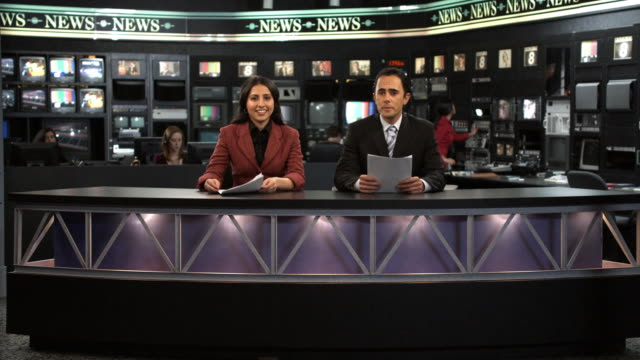 MS Anchors talking at news desk, Dallas, Texas, USA