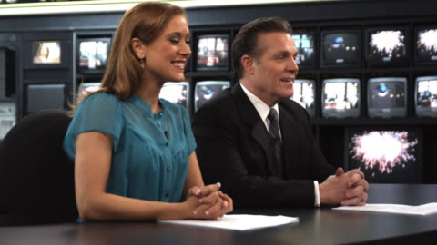 ms anchors talking at newsroom desk, dallas, texas, usa - 1 minute or greater stock videos & royalty-free footage