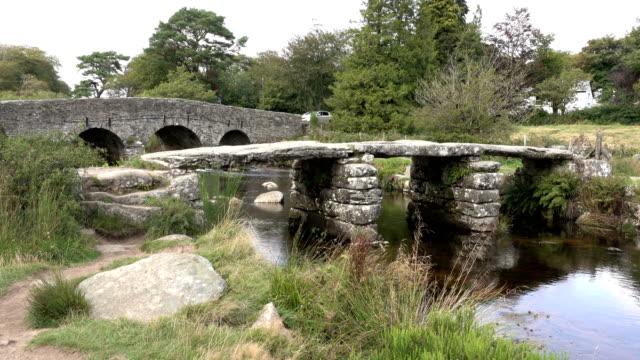 ancient 13th century clapper bridge east dart river postbridge dartmoor national park devon england - dartmoor stock videos & royalty-free footage
