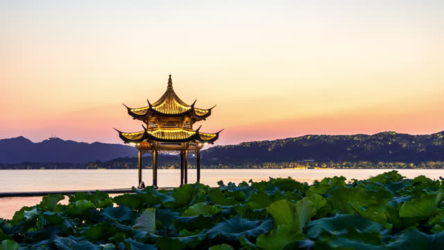 ancient architecture in west lake of hangzhou. timelapse day to night - pavilion video stock e b–roll