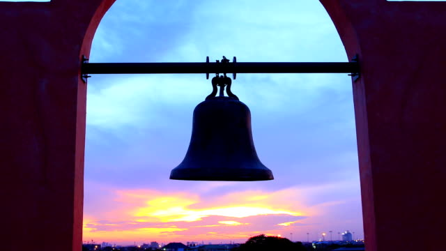 ancient bell against colorful sunset - bell stock videos & royalty-free footage