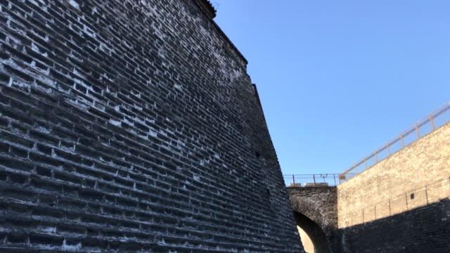 ancient brick wall at ming dynasty wall relics park , beijing , china. - stone wall stock videos & royalty-free footage