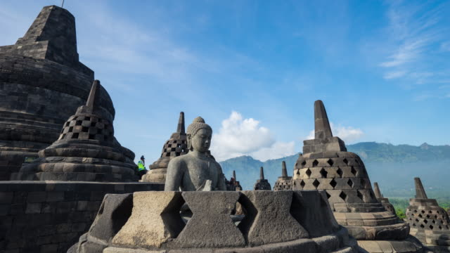 ancient buddha statue and stupa at borobudur temple in yogyakarta, java, indonesia. - jakarta stock videos & royalty-free footage