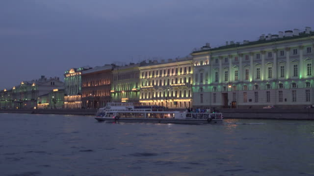 Ancient buildings and tourist cruise ship on Neva river
