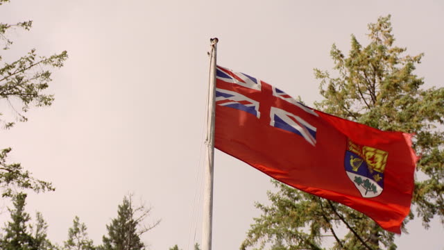 a ancient canadian flag used until 1965 before it became the flag with the red maple leaf - 1965 stock videos & royalty-free footage