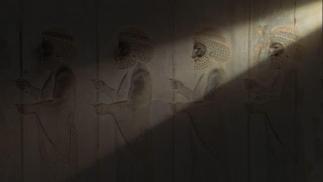 ancient carvings of persepolis in shiraz city, iran. - persepoli video stock e b–roll
