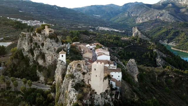 Ancient castle in Guadalest at sunset, Spain. Drone video