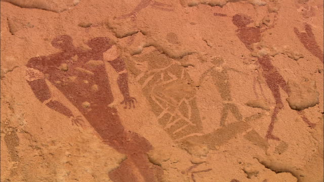 ancient cave art depicts a human family. - prehistoric era stock videos & royalty-free footage