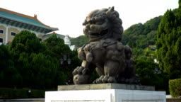 Ancient Chinese Guardian Lion Statue in Temple
